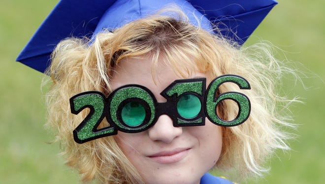 Sheboygan North's Monica McClure wears 2016 sunglasses at commencement  Sunday June 5, 2016 in Sheboygan.