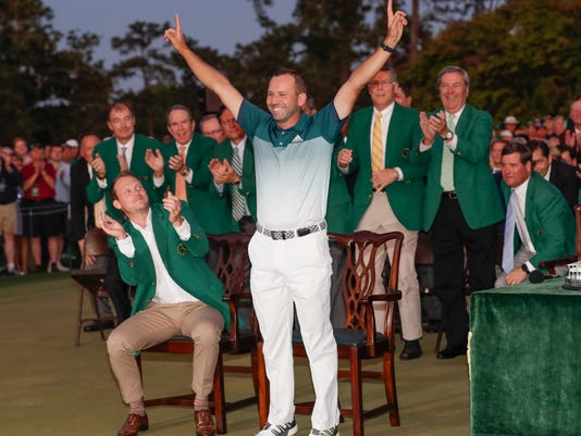 Sergio Garcia, of Spain, reacts at the green jacket ceremony after winning the Masters golf tournament Sunday, April 9, 2017, in Augusta, Ga. (AP Photo/David J. Phillip)