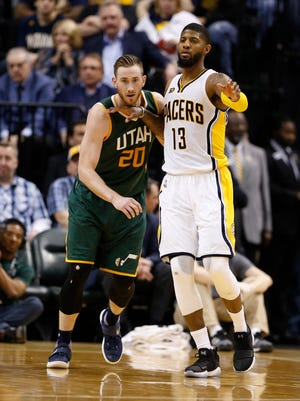 Mar 20, 2017; Indianapolis, IN, USA; Indiana Pacers forward Paul George (13) is guarded by Utah Jazz forward Gordon Hayward (20) at Bankers Life Fieldhouse. Indiana defeated Utah 107-100.