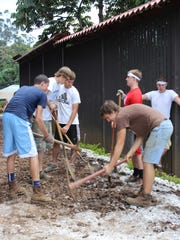 Shalom Christian Academy students help with a building project during their trip to Costa Rica. The senior class trip included teaching children and helping a community with chores. (submitted)