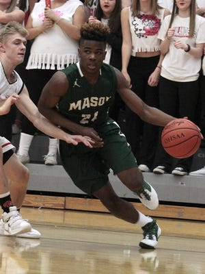 Mason's Kyle Lamotte turns the corner and drives the baseline against Oak Hills on Friday night. He tied for the team lead with eight points.