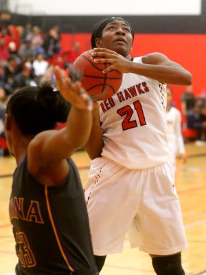 Stewarts Creek's Jamya Rogers (21) goes up for shot as she was guarded by Smyrna's Kesha Brady (33) on Tuesday, Jan. 17, 2017.