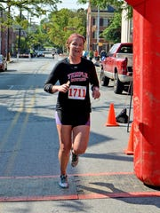 Anne Buckley, 24, of Philadelphia, finishes as the