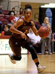 Midwestern State's Jasmine Richardson drives to the