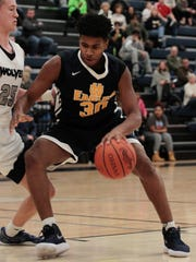 Nic Smith of Walnut Hills muscles his way into the
