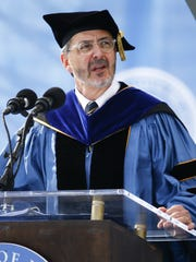 Provost Domenico Grasso addresses the gathering as the University of Delaware holds its 168th Commencement in 2017.