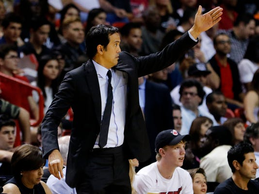 Miami Heat head coach Erik Spoelstra directs his team against the Detroit Pistons in the first quarterof an NBA basketball game, Tuesday, April 5, 2016, in Miami. (AP Photo/Joe Skipper)