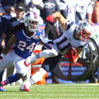 In this file photo, Patriots receiver Julian Edelman (11) slips past Bills Stephon Gilmore after a catch. Edelman has been evasive regarding questions about a possible head injury he suffered in the Super Bowl, that has helped lead to NFL adopting a third-party concussion timeout.