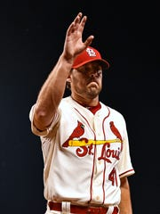 St. Louis Cardinals starting pitcher John Lackey (41) waves to fans as he leaves the game against the Miami Marlins at Busch Stadium.   Jasen Vinlove-USA TODAY Sports