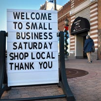 A sign announces a store's participation in Small Business Saturday.
