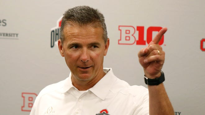 In this Aug. 16, 2015, file photo, Ohio State coach Urban Meyer speaks to reporters during the university's NCAA college football media day in Columbus, Ohio.