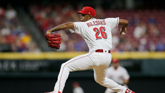Cincinnati Reds relief pitcher Raisel Iglesias (26) delivers a pitch in the top of the ninth inning of the MLB National League game between the Cincinnati Reds and the Chicago Cubs at Great American Ball Park in downtown Cincinnati on Friday, June 22, 2018. The Reds won 6-3.