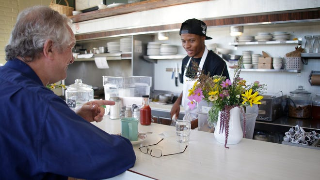 Rose's Fine Food regular Francis Dutoit, left, of Detroit, chats with chef Esa Miyazaan, 21, of Detroit  Monday September 12, 2016.