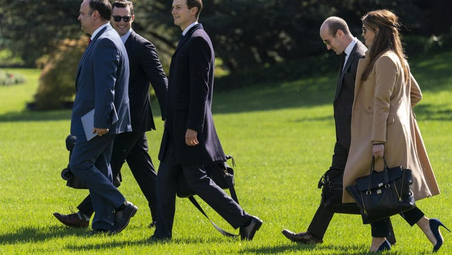 From left, Dan Scavino, Nicholas Luna, Jared Kushner, Stephen Miller, and Hope Hicks walk to board Marine One with President Donald Trump at the White House, Wednesday, Sept. 30, in Washington, for the short trip to Andrews Air Force Base en route to Minnesota. Hicks tested positive for coronavirus on Thursday.
