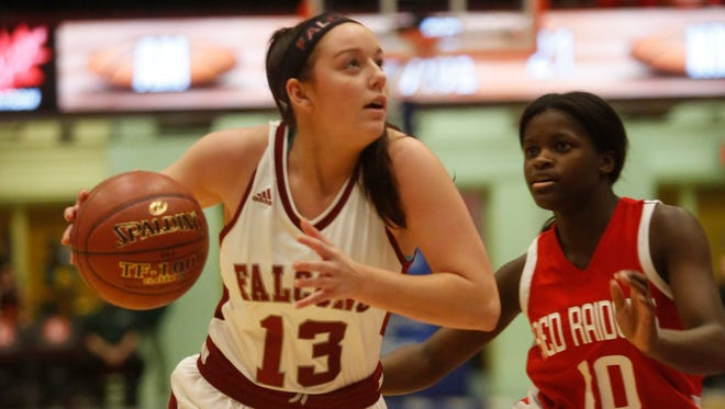 Albertus Magnus' Elizabeth Benedetto (13) drives around North Rockland's Danielle Cajou (10) during the 18th Slam Dunk Tournament at the Westchester County Center in White Plains on Dec. 26, 2016.  Magnus won 69- 45.