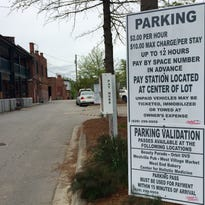 Business owners in the Bledsoe Building in West Asheville will now charge for unvalidated parking in thier lot.