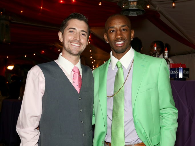 Matt Case, left  and University of Louisville basketball player Russ Smith at Ferdinand's Ball at the Muhammad Ali Center in Louisville. May 1, 2014.