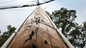 Slim plastic pipes affixed to a utility pole in Mahwah are part of an eruv, a symbolic boundary that allows Orthodox Jews to perform tasks outside their homes that usually are prohibited on the Sabbath.