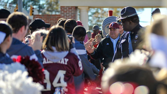 Coach Blakeney greets fans during the Trojan Walk  prior to final game of his career in Troy, Ala. on Saturday, November 29, 2014.