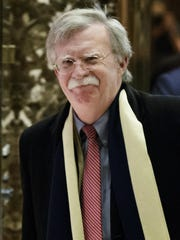 Former U.S. ambassador to the United Nations John Bolton waves following a meeting with then-president-elect Donald Trump at Trump Tower in New York in December 2016.