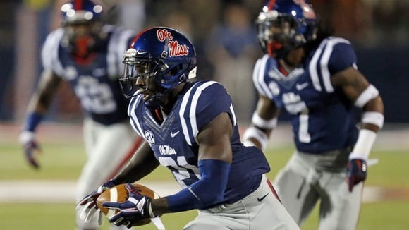 Mississippi defensive back Senquez Golson (21) runs with an interception of a Tennessee pass during the first half of an NCAA college football game in Oxford, Miss., Saturday, Oct. 18, 2014. No. 3 Mississippi won 34-3. (AP Photo/Rogelio V. Solis)