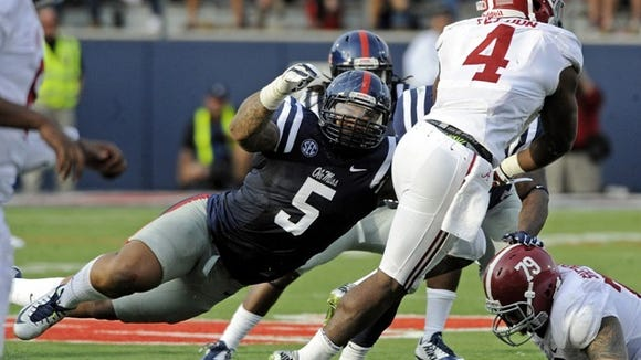 Mississippi defensive tackle Robert Nkemdiche (5) pressures Alabama running back T.J. Yeldon (4) during the second half of an NCAA college football game in Oxford, Miss., Saturday, Oct. 4, 2014. (AP Photo/The Daily Mississippian, Thomas Graning)