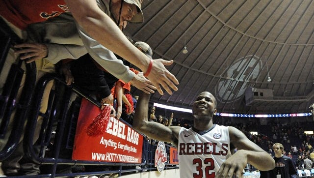 Mississippi guard Jarvis Summers (32) celebrates with fans after an NCAA college basketball game against Mississippi State in Oxford, Miss., Wednesday, Jan. 28, 2015. Mississippi won 79-73. (AP Photo/Thomas Graning)