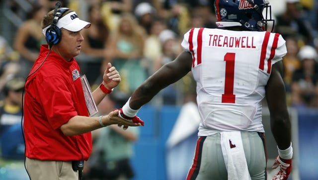 Ole Miss coach Hugh Freeze with wide receiver Laquon Treadwell