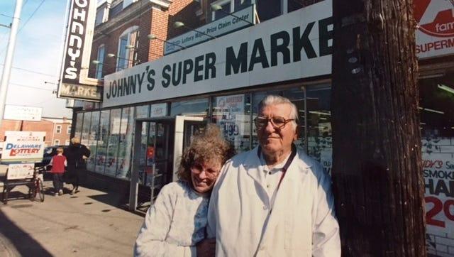 A 1995 photo of John Kaminski and his daughter Bernice at Johnny's Super Market, a city landmark.