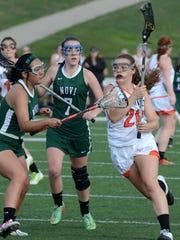 Northville's Kendall Wasik (right) goes in for the