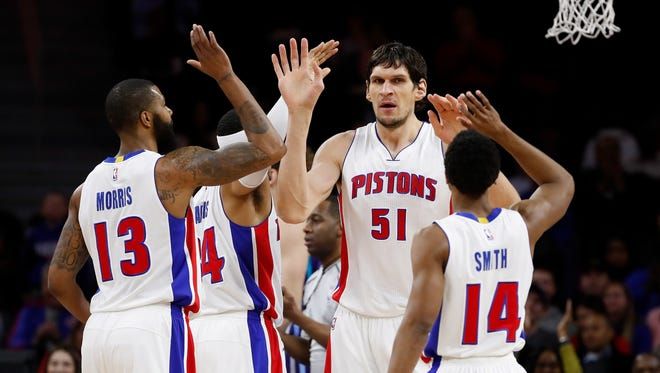 Pistons center Boban Marjanovic (51) celebrates with Ish Smith, Marcus Morris and Tobias Harris while playing the Hornets at the Palace on Jan. 5, 2017.