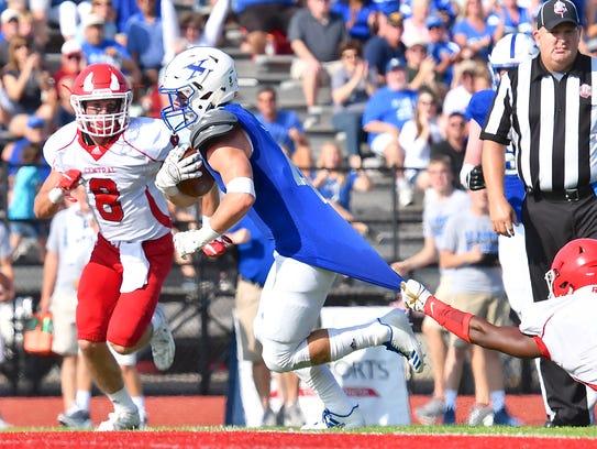 St. Xavier's Matt Fox scores a touchdown in the first