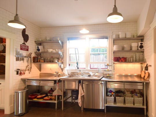 """The kitchen — which originally was an """"elephant grey"""