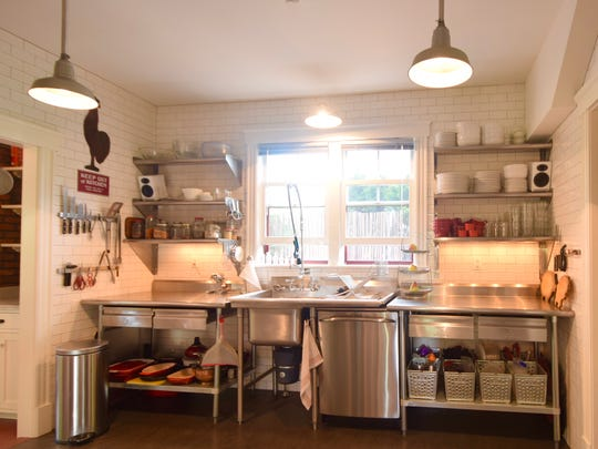 "The kitchen — which originally was an ""elephant grey Formica"" — is now industrial chic."