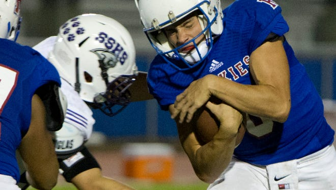 Reno Huskies quarterback Isaac Terrasas is hit by a Spanish Springs Cougars defender during their football game on  October 16 at Reno.