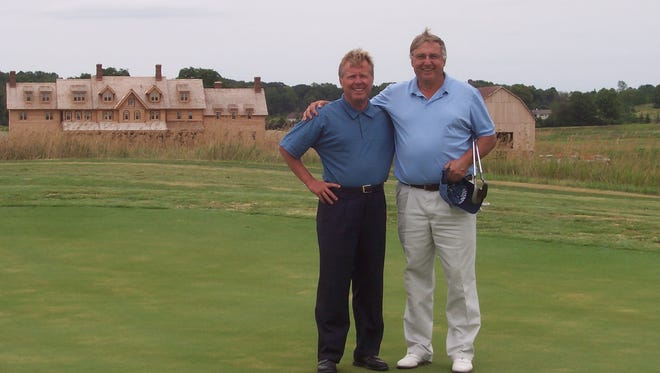 Erin Hills owner Bob Lang (left) poses with Steve Stricker's father-in-law, PGA professional Dennis Tiziani, after Tiziani, Stricker and others were invited to play the fledgling golf course in July 2006.
