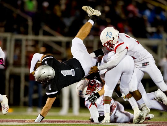 Alcoa's Walker Russell (1) dives for a play during