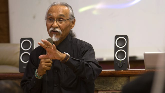 Huerfano Chapter President Wilson Ray Jr., talks Thursday during a public scoping meeting hosted by the Bureau of Indian Affairs and the Bureau of Land Management at the Huerfano Chapter House.