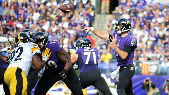 Baltimore Ravens quarterback Joe Flacco (5) throws a touchdown pass to wide receiver Mike Wallace (not pictured) in the first quarter against the Pittsburgh Steelers at M&T Bank Stadium.