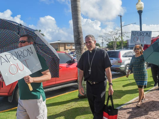 Coadjutor Archbishop Michael Byrnes, on Jan. 29, 2017, briefly joins the picket line, organized every Sunday, by those who oppose Archbishop Anthony Apuron, at the Dulce Nombre de Maria Cathedral-Basilica in Hagåtña.