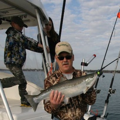 Steve Meurett and Co. tussle with a coho, one of the eight fish they caught on the afternoon.