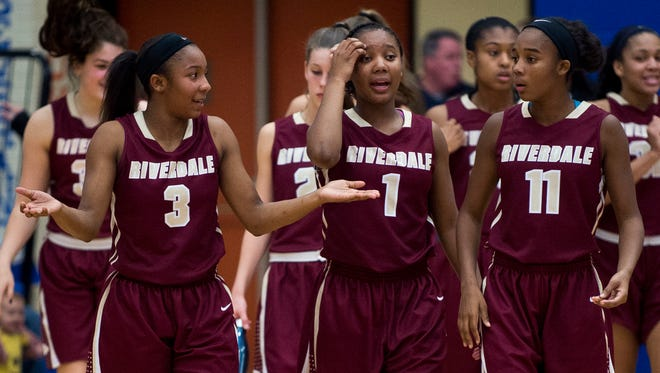 Riverdale guard Anastasia Hayes (3) walks onto the court with her sisters Alasia Hayes (1) and Aislynn Hayes (11) after halftime during Riverdale's game against William Blount on Tuesday, Nov. 22, 2016.