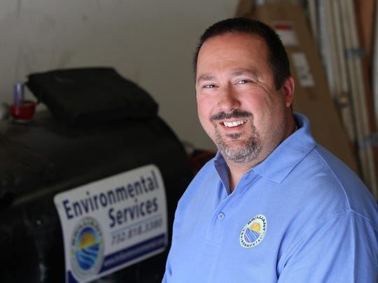 Philip I. Brilliant, owner of Brilliant Environmental Services, stands inside an equipment garage at his office in Toms River.