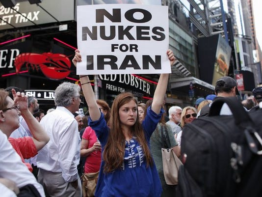 635763645135401397-Iran-deal-protester