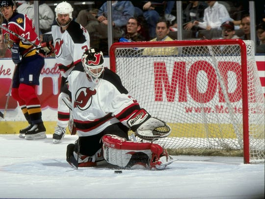 The great Martin Brodeur makes a save for the New Jersey