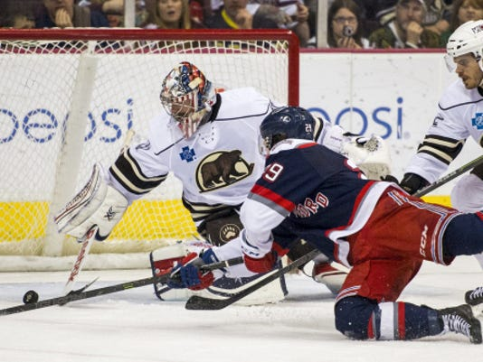 Hershey's Philipp Grubauer makes a save on Hartford's Danny Kristo during Game 5 of the AHL playoffs at Giant Center on Wednesday.