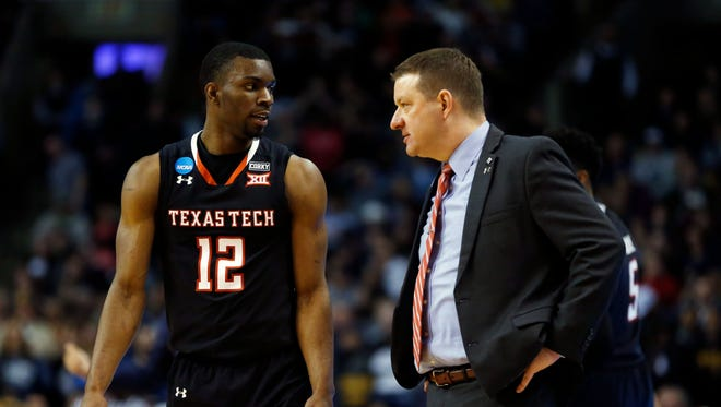 Texas Tech guard Keenan Evans and coach Chris Beard talk during a timeout in the East regional championship game of the NCAA tournament at the TD Garden in Boston on March 25, 2018.