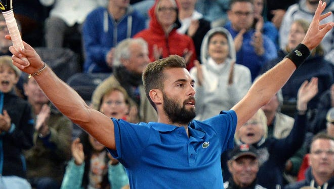 Benoit Paire of France reacts after beating Tommy Robredo of Spain in their second-round match at the Hamburg Open.