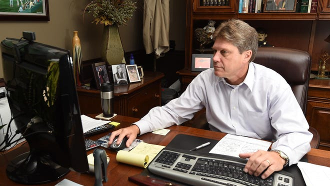 Baxter County Sheriff John Montgomery works Thursday in his office. Montgomery was recently elected president of the Arkansas Sheriffs' Association.