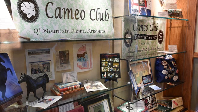 A display at the Donald W. Reynolds Library shows the highlights of the Cameo Club of Mountain Home's 50 years of service to the community. The Cameo Club will celebrate its 50th anniversary and homecoming from 2-4 p.m. Saturday at the library.